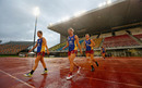 Delissa Kimmince (centre) walks out to train with some of her Brisbane Lions AFL Women's team-mates, Brisbane, Australia, March 22, 2017