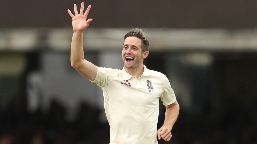 How many fingers do you see? Chris Woakes is ecstatic after his fifth wicket
