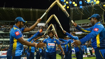 Lasith Malinga receives a guard of honour as he walks out for the last time in ODI cricket
