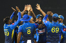 Lasith Malinga is swarmed by his team-mates, Sri Lanka v Bangladesh, 1st ODI, Colombo