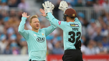 Gareth Batty gets a high five from Ollie Pope
