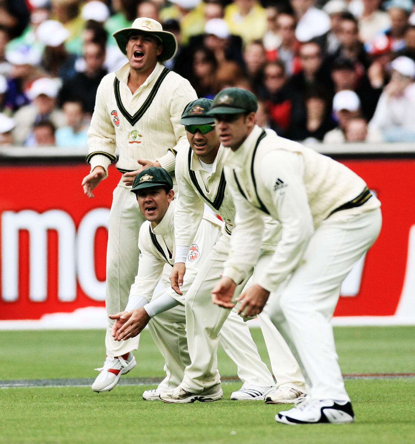 The floppy among the baggy greens: Warne sports a lone hat in the Australian slips, 2006