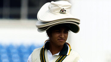 Lisa Sthalekar carries hats and drinks for her team-mates