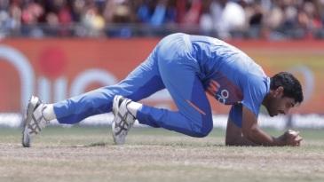 Bhuvneshwar Kumar clings onto a return catch