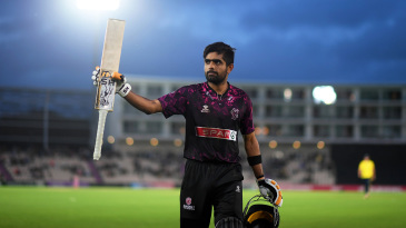 Babar Azam walks off after reaching his hundred from the final ball