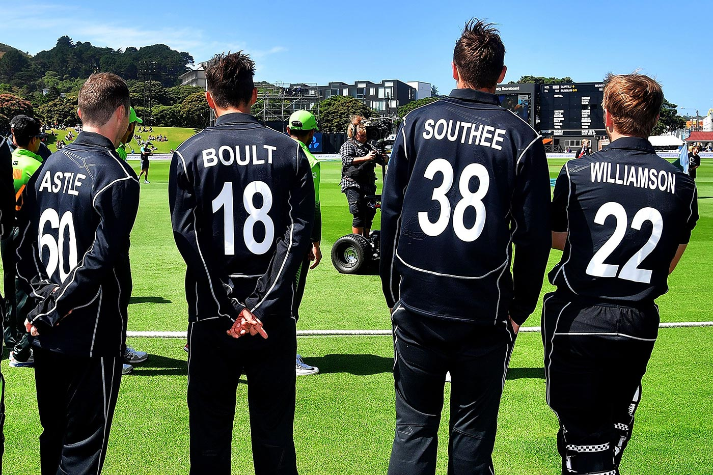 Todd Astle, Trent Boult, Tim Southee and Kane Williamson stand by the boundary