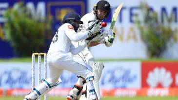 Tom Latham steers the ball past Niroshan Dickwella