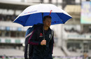 Jos Buttler hides away from the rain at Lord's, England v Australia, 2nd Test, Lord's, August 14, 2019
