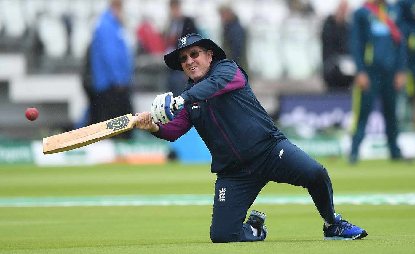 A sodden Trevor Bayliss dishes up some catching practice