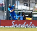 Mohammed Shami is airborne as he rifles in a throw, West Indies v India, 3rd ODI, Port of Spain, August 14, 2019
