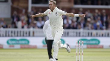 Stuart Broad wheels away in celebration after bowling David Warner