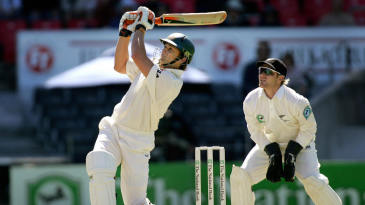 Adam Gilchrist hits Daniel Vettori for six as Brendon McCullum looks on