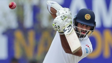 Dimuth Karunaratne punches with a high elbow