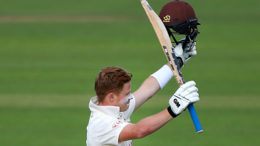 Ollie Pope raises his bat on reaching three figures