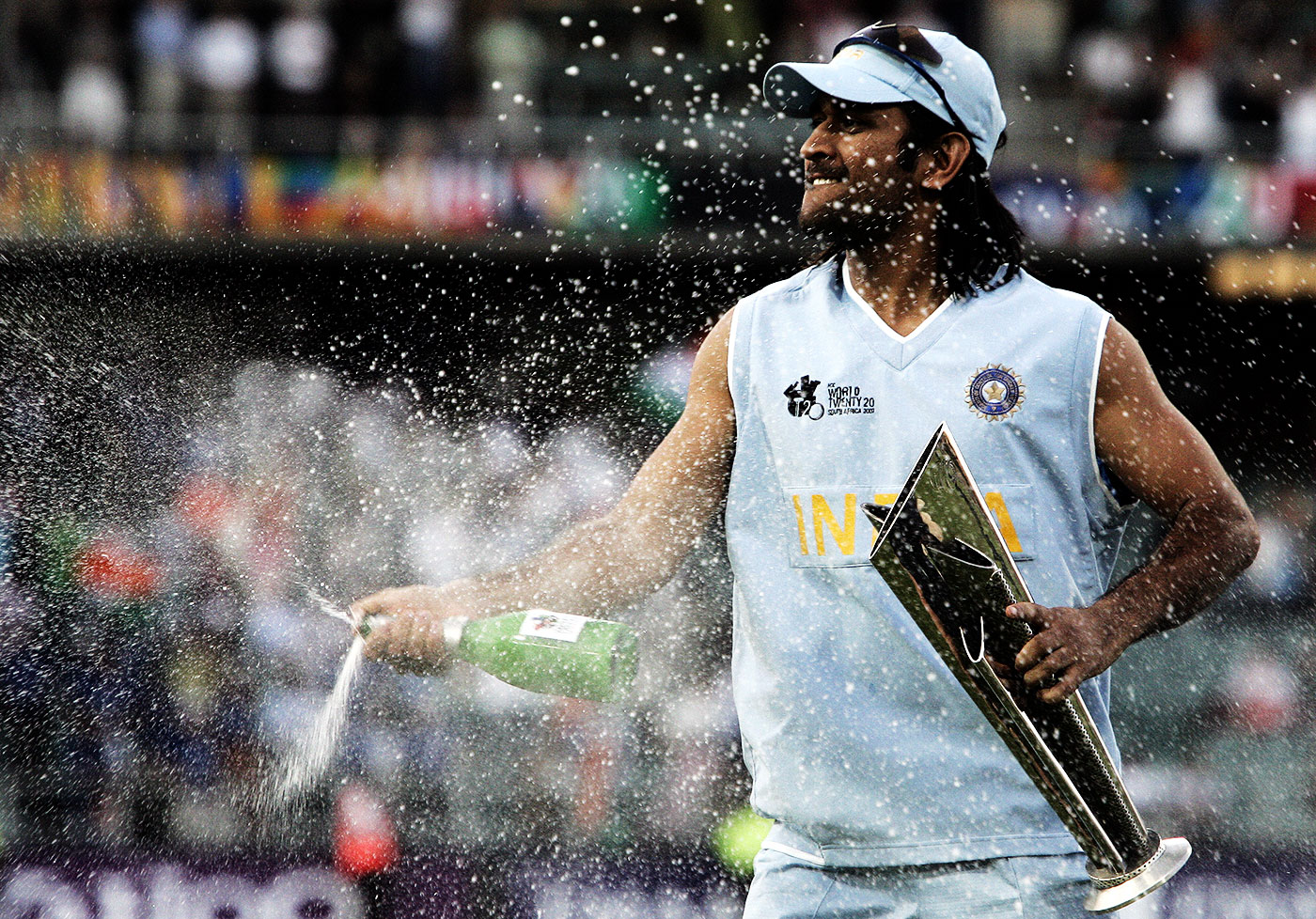 MS Dhoni sprays open a bottle of champagne