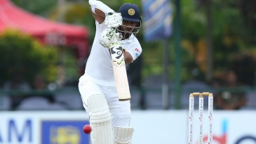 Dimuth Karunaratne plays one straight down the ground