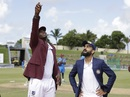 Jason Holder tosses the coin as Virat Kohli looks on, West Indies v India, 1st Test, North Sound, 1st day, August 22, 2019