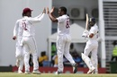 Shannon Gabriel and Kraigg Brathwaite celebrate Virat Kohli's wicket, West Indies v India, 1st Test, North Sound, 1st day, August 22, 2019