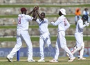 Kemar Roach celebrates a wicket with his team-mates, West Indies v India, 1st Test, North Sound, 1st day, August 22, 2019