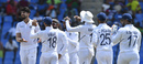 Ishant Sharma is surrounded by team-mates in the celebrations, West Indies v India, 1st Test, North Sound, 2nd day, August 23, 2019