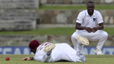 Kemar Roach looks on as John Campbell drops Ajinkya Rahane's catch