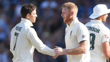 Tim Paine offers a handshake to Ben Stokes