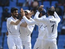 Jasprit Bumrah is swarmed by his team-mates, West Indies v India, 1st Test, North Sound, 4th day, August 25, 2019