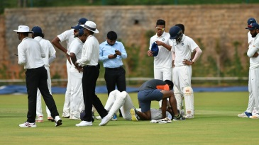Priyam Garg gets attention from the team physio after being struck on the neck