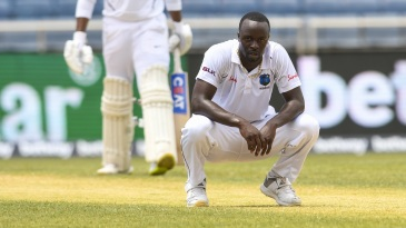Kemar Roach reacts with relief after getting Mayank Agarwal out lbw