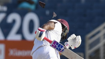 Darren Bravo cops a blow to the side of the helmet off a Jasprit Bumrah bouncer