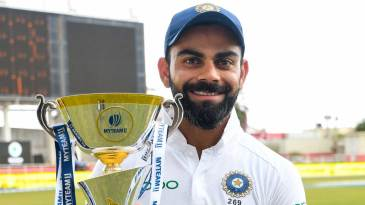 Virat Kohli poses with the series trophy