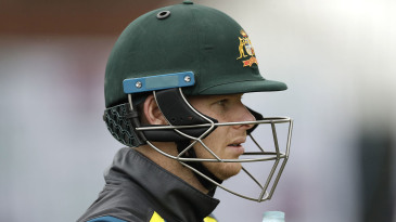 Steven Smith - wearing stem guards on his helmet - prepares for a net ahead of the Old Trafford Test