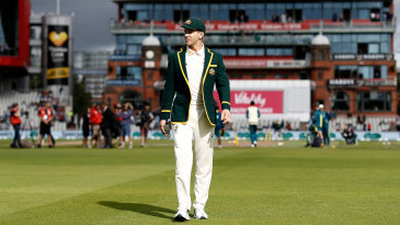Tim Paine walks out to the toss at Old Trafford