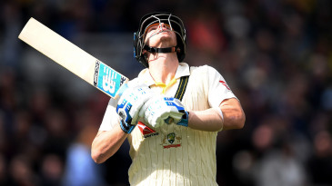 Steven Smith looks to the skies as he walks out to bat
