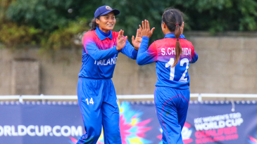 Thailand's Soraya Lateh high fives Chanida Sutthiruang for taking another wicket