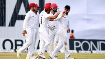 Rashid Khan celebrates a wicket with his team-mates