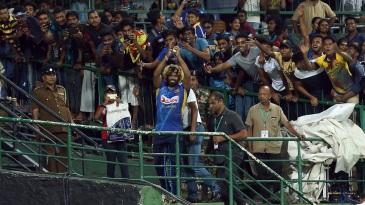 Lasith Malinga celebrates the feat with fans in Pallekele