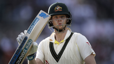 Steve Smith raises his bat as he leaves the ground after being dismissed for 82