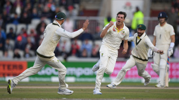Pat Cummins celebrates with team-mates after dismissing Joe Root for 0