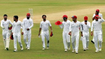 The Afghanistan players walk off the field