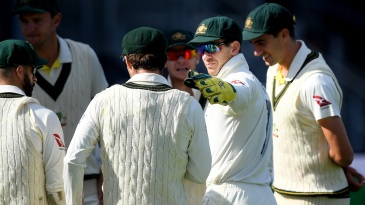Tim Paine directs strategy at the start of play