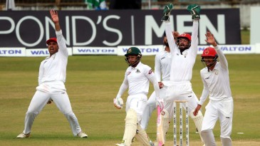The Afghanistan players go up in appeal for Mushfiqur Rahim's wicket