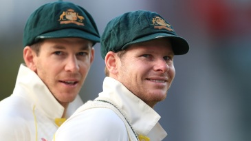 Tim Paine and Steven Smith during the day's play