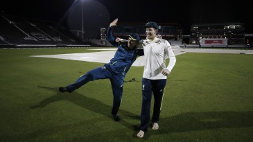 Justin Langer and Tim Paine celebrate after Australia claim victory