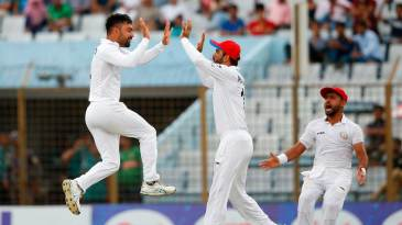 Rashid Khan leaps off the ground to celebrate a wicket