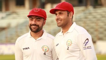 Smile while you're winning - Rashid Khan and Mohammad Nabi after the Test victory