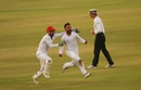 Rashid Khan sets off on a celebratory run, with Afsar Zazai in pursuit, after the last wicket, Bangladesh v Afghanistan, Only Test, Chattogram, 5th day, September 9, 2019