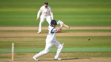 Dom Sibley drives through the covers