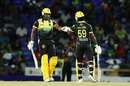 Chris Gayle and Chadwick Walton fist-bump during their partnership, St Kitts and Nevis Patriots v Jamaica Tallawahs, Basseterre, CPL 2019, September 10, 2019