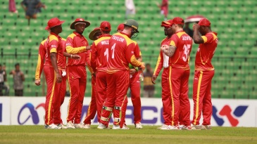 The Zimbabwe players celebrate a wicket in their tour game